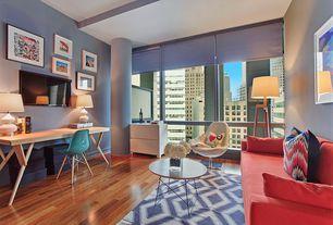Contemporary Living Room with Ikat pattern, Floor lamp, Area rug, Overman Swivel Chair (Set of 2), Columns, Hardwood floors