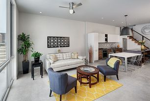 Contemporary Great Room with Built-in bookshelf, Nuevo dome pendant hgml259, Concrete floors, Ceiling fan, Pendant light