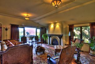 Mediterranean Living Room with insert fireplace, can lights, High ceiling, flush light, slate floors, Casement, Fireplace
