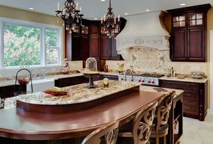 Traditional Kitchen with Raised panel, Limestone Tile, Farmhouse sink, Breakfast bar, Kitchen island, limestone tile floors
