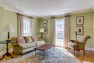 Traditional Living Room with Hardwood floors, double-hung window, Standard height, Crown molding