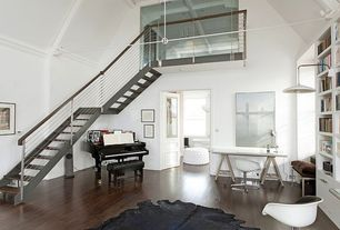 Modern Master Bedroom with Steel staircase, Round tufted ottoman, Black brazilian cowhide rug, Steel staircase