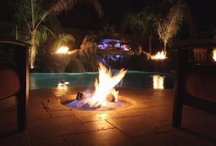 Tropical Patio with exterior stone floors, Fire pit, Fountain