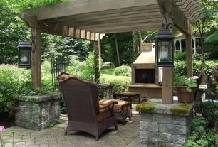 Traditional Patio with outdoor pizza oven, exterior brick floors, Trellis