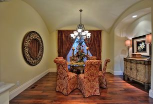 Mediterranean Dining Room with Hardwood floors, High ceiling, Chandelier, can lights, picture window