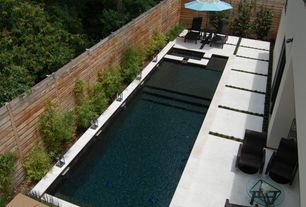 Modern Swimming Pool with Fence, exterior tile floors, Pathway, Lap pool