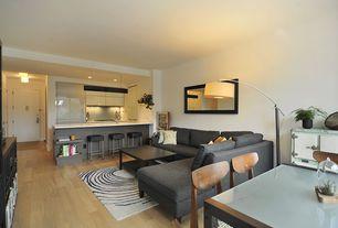 Modern Living Room with Exposed beam, Danish Dining Chairs - Mid Century Modern, Hardwood floors, West Elm Dunham Sectional