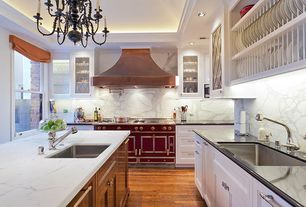 Traditional Kitchen with Chandelier, Simple granite counters, Kitchen island, Complex marble counters, Glass panel, U-shaped