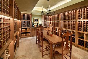 Traditional Wine Cellar with limestone floors, Chandelier, High ceiling
