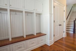 "Cottage Mud Room with Built-in bookshelf, Mullican flooring oak gunstock 3/8"" thick 5"" wide, Crown molding, Hardwood floors"