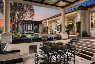 Traditional Porch with exterior stone floors, Trellis, Outdoor kitchen, Fence, Screened porch, specialty window