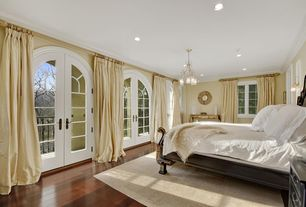Traditional Master Bedroom with can lights, Casement, Standard height, Striated Flatweave Rug -Sant, Paint 1, Paint 2