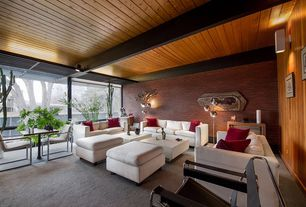 Modern Living Room with flush light, Wall sconce, Carpet, interior brick, Exposed beam