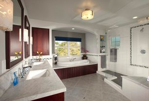 Craftsman Master Bathroom with Shower, Bathtub, Casement, Inset cabinets, stone tile floors, Raised panel, can lights