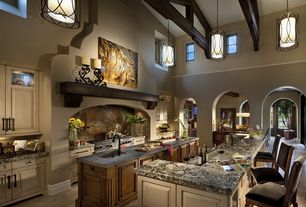 Mediterranean Kitchen with Slate counters, Complex granite counters, Flush, High ceiling, Glass panel, Pendant light, Slate