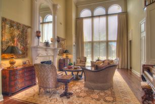 Traditional Living Room with Hardwood floors, Loft, specialty door, picture window, Arched window, Crown molding, Fireplace