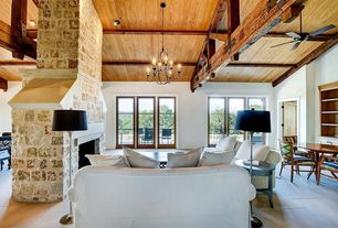 Rustic Living Room with flush light, stone fireplace, Chandelier, sandstone floors, High ceiling, Exposed beam