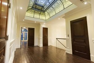 Traditional Hallway with Crown molding, specialty door, French doors, Hardwood floors, High ceiling, Wainscotting, can lights