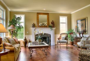 Traditional Living Room with Crown molding, stone fireplace, Wainscotting, Hardwood floors