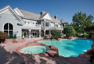 Traditional Swimming Pool with Pool with hot tub, exterior tile floors, Arched window, sliding glass door, Outdoor kitchen