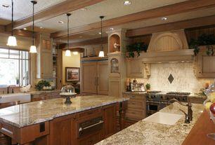Traditional Kitchen with Hardwood floors, Flat panel cabinets, full backsplash, Casement, Framed Partial Panel, can lights