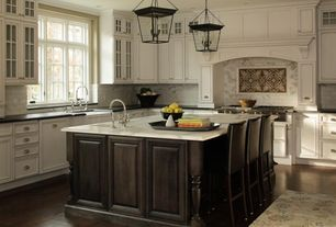 Traditional Kitchen with Complex marble counters, Kitchen island, Kitchen Bridge Faucet with Side Spray, Stone Tile, L-shaped