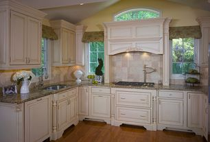 Traditional Kitchen with Undermount sink, Simple granite counters, Stone Tile, Raised panel, U-shaped, Slate Tile