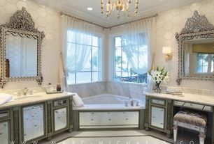 Art Deco Master Bathroom with interior wallpaper, Wall sconce, Mirror cabinetry, Standard height, Complex marble counters