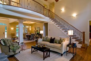 Traditional Great Room with Wall sconce, Cathedral ceiling, Loft, Ceiling fan, Hardwood floors, Columns, Crown molding
