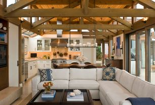Craftsman Great Room with Exposed beam, Concrete tile , Pendant light, French doors, Cathedral ceiling, Built-in bookshelf