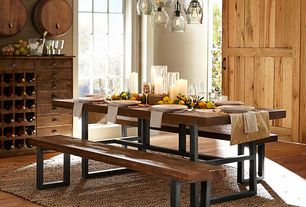 Traditional Dining Room with Wine Barrel Wall-Mounted Drink Dispenser, Carpet, Griffin reclaimed wood fixed dining table