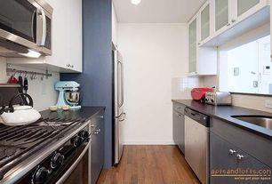 Modern Kitchen with European Cabinets, Galley, gas range, Undermount sink, Glass panel, built-in microwave, Standard height