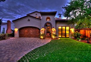 Mediterranean Garage with High ceiling, Arched doorway, Barn door, Stone pavers