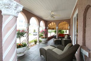 Mediterranean Porch with South Sea Rattan Saint Tropez Deep Seating Chair with Cushion, Raised beds, exterior awning