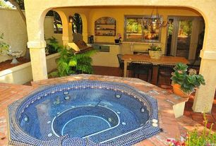 Eclectic Hot Tub with French doors, Raised beds, Fence, Bird bath, Outdoor kitchen, exterior brick floors