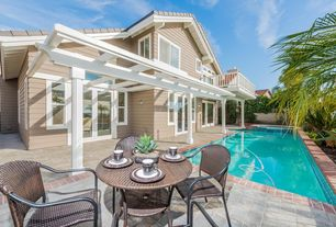 Traditional Swimming Pool with French doors, Fence, exterior tile floors, Raised beds, Trellis