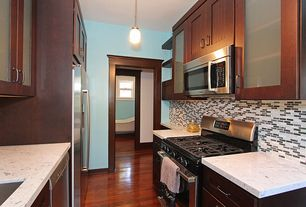 Contemporary Kitchen with gas range, Glass panel, Pendant light, full backsplash, Simple granite counters, built-in microwave