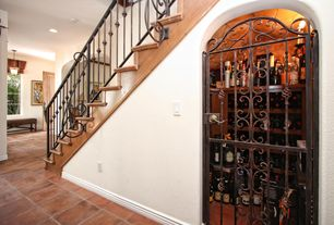 Mediterranean Wine Cellar with Standard height, Saloon door, terracotta tile floors, Wall sconce