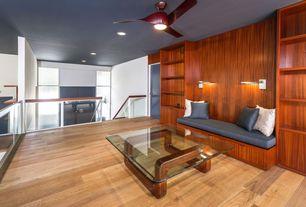 Contemporary Living Room with flat door, Hardwood floors, Standard height, Ceiling fan, Built-in bookshelf