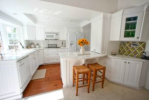 Traditional Kitchen with Kitchen peninsula, double-hung window, Crown molding, Built In Panel Ready Refrigerator, L-shaped