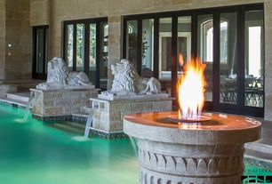 Traditional Swimming Pool with Fountain, Fire pit, French doors, exterior stone floors, Indoor pool