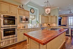 Country Kitchen with Raised panel, Crown molding, double wall oven, High ceiling, built-in microwave, Casement, Wood counters