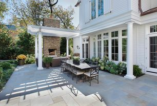 Traditional Patio with Trellis, Transom window, Pathway, exterior stone floors, Fence, French doors