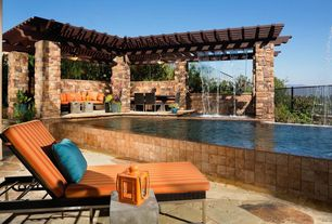 Mediterranean Swimming Pool with Lap pool, Fountain, Fence, exterior stone floors, Trellis
