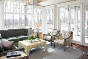 Traditional Living Room with Hardwood floors, Casement, French doors, picture window, flush light, High ceiling