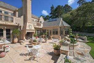 Traditional Patio with French doors, Pathway, exterior stone floors, Skylight, Outdoor kitchen, Deck Railing, Raised beds