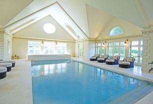 Traditional Swimming Pool with French doors, Pathway, Transom window, exterior stone floors, Arched window, Indoor pool