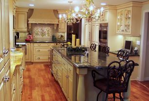 Traditional Kitchen with Crown molding, full backsplash, Framed Partial Panel, Chandelier, can lights, Undermount sink