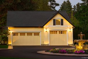 Cottage Garage with can lights, picture window, High ceiling, specialty door