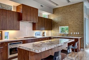 Contemporary Kitchen with Simple Granite, picture window, L-shaped, Custom hood, Simple granite counters, wall oven, Flush